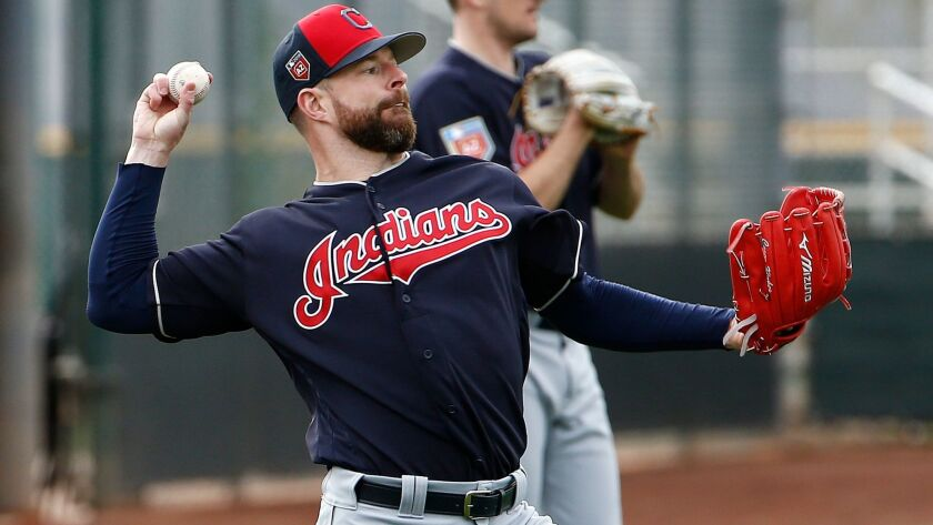 Cleveland Indians starting pitcher Corey Kluber warms up with other pitchers at the Indians spring t