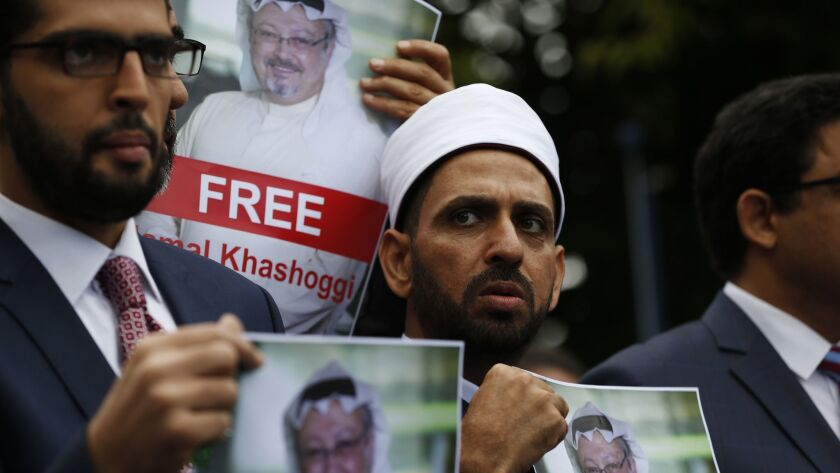 Members of the Turkish-Arab journalist association hold posters with photos of missing Saudi writer Jamal Khashoggi, as they hold a protest near the Saudi Arabia Consulate in Istanbul on Monday.
