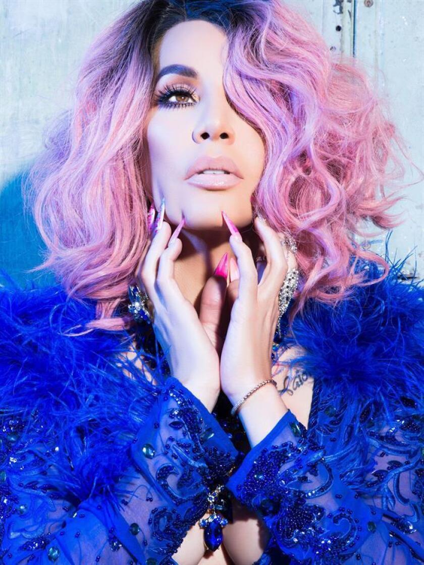 """Fotografía promocional cedida por Imagine It Media donde aparece la reguetonera puertorriqueña Ivy Queen, una de las pioneras del género urbano latino a principios de la década de 1990, quien se encuentra promocionando su nueva producción musical y décimo disco de estudio, """"Llegó La Queen"""", en la que se destaca como la reina del cadencioso ritmo. EFE/Imagine It Media/SOLO USO EDITORIAL/NO VENTAS"""