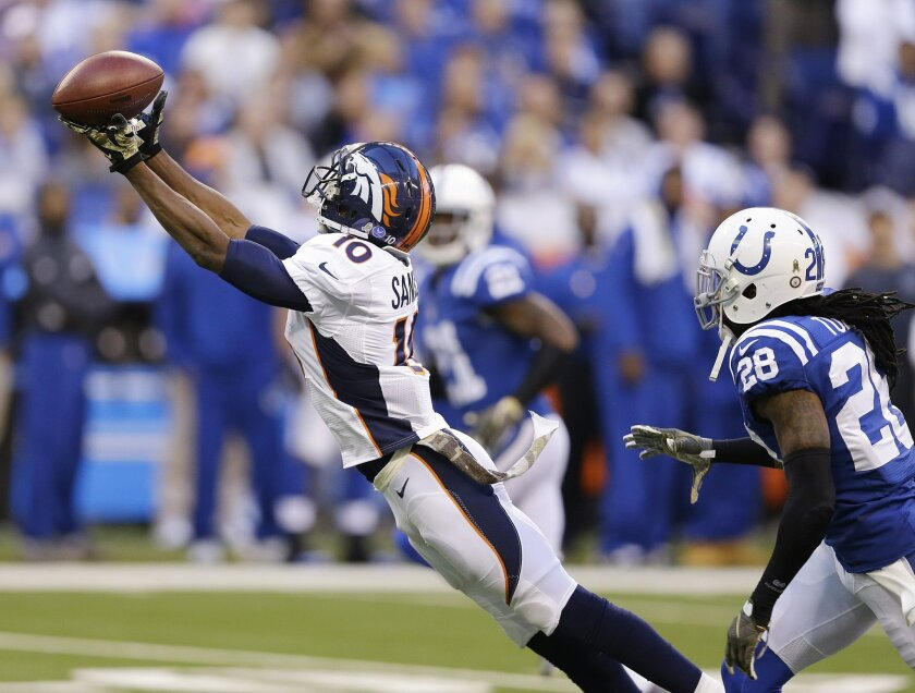 Denver Broncos' Emmanuel Sanders (10) tries to make a catch while being defended by Indianapolis Colts' Greg Toler (28) during the first half of an NFL football game, Sunday, Nov. 8, 2015, Indianapolis. The pass was incomplete. (AP Photo/Michael Conroy)