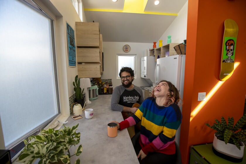 A couple sit at a counter inside Casita L.A.