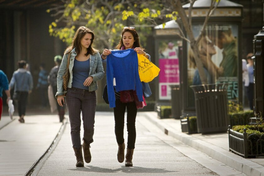 Shoppers at the Americana at Brand in Glendale. Retail sales in June beat expectations.