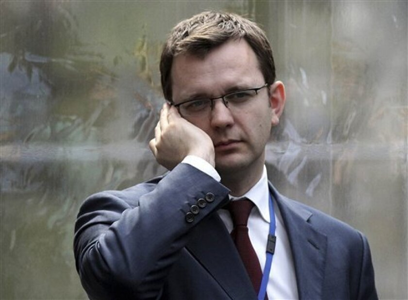 FILE - In this April 13, 2010 file photo, Andy Coulson, formerly editor of the tabloid News of the World, and later David Cameron's director of communications, speaks on a mobile phone in London. London police on Friday, July 8, 2011, arrested Andy Coulson, the former News of the World editor who also served as the prime minister's former communications chief, in relation to Britain's tabloid phone-hacking scandal. London police said a 43-year-old man was arrested Friday morning over allegations of phone hacking and police bribery and was in custody at a London police station. They did not name him but offered the information when asked about Coulson. (AP Photo/Oli Scarff, Pool, file)