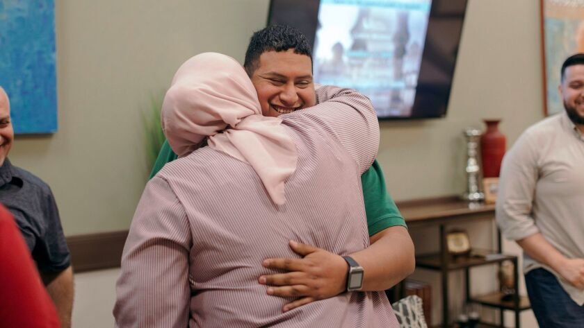 New member Armando Segura, 28, of Houston, embraces his sister following a short ceremony welcoming him to the congregation March 3 at Centro Islámico mosque in Houston.