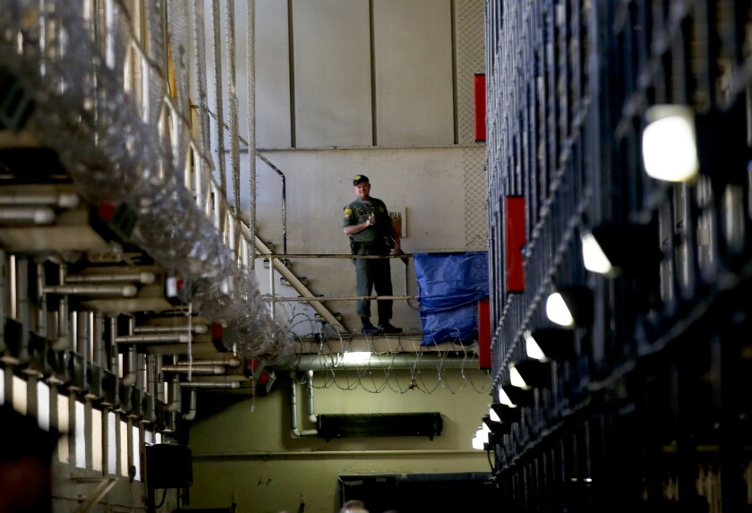 A guard stands watch over the condemned prisoners housed in East Block at San Quentin State Prison.