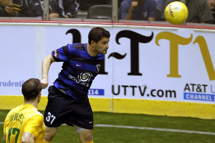 San Diego Sockers Kraig Chiles heads the ball against Detroit in the PASL Championship.