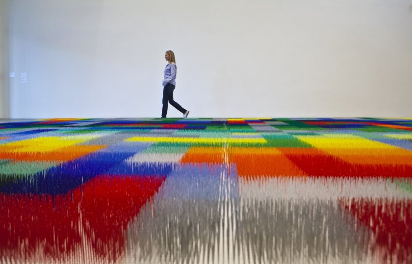 """Liza Lou and her """"Color Field"""" at the Museum of Contemporary Art San Diego downtown. Photo: Crissy Pascual/Infinite Media Works"""