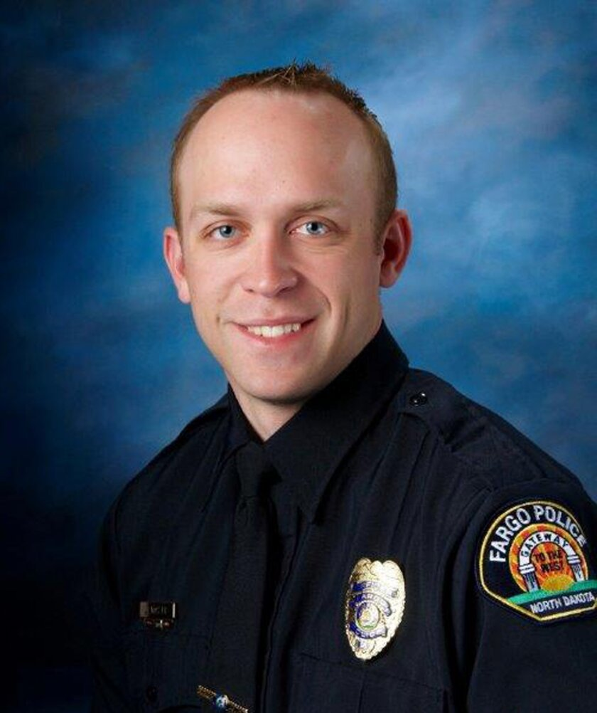 This undated photo released by Fargo Police Department shows Fargo police officer Jason Moszer. Moszer was shot amid a standoff in Fargo, N.D. with a domestic violence suspect, police in North Dakota said early Thursday, Feb. 10, 2016. Moszer, 33, responded to the standoff Wednesday night and parke