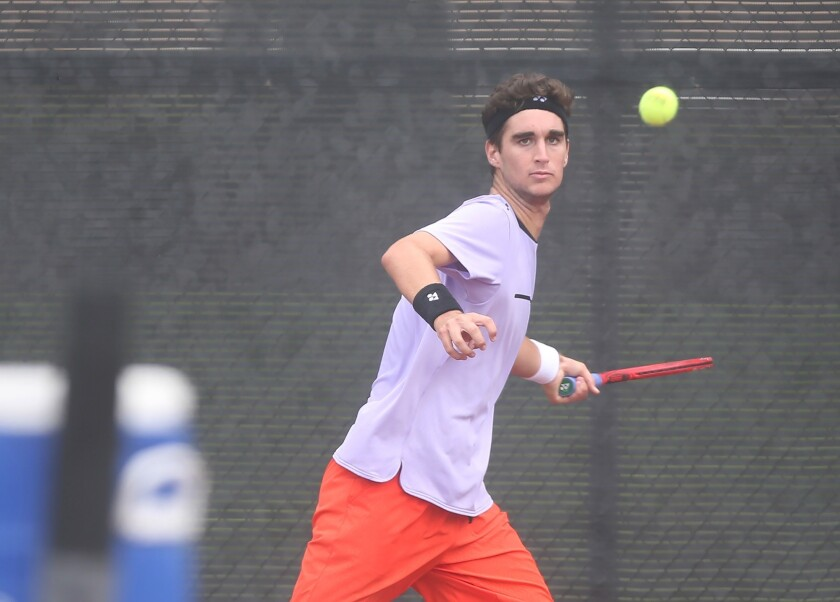 Number one seed Max McKennon eyes a forehand in match against opponent Tyler Davis, in the boys' 1