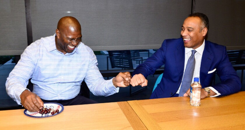 Dodgers co-owner Magic Johnson, left, shares a laugh with David Rone, President of Time Warner Cable sports, news and local programming during the launch of SportsNet LA in El Segundo on Feb. 25.