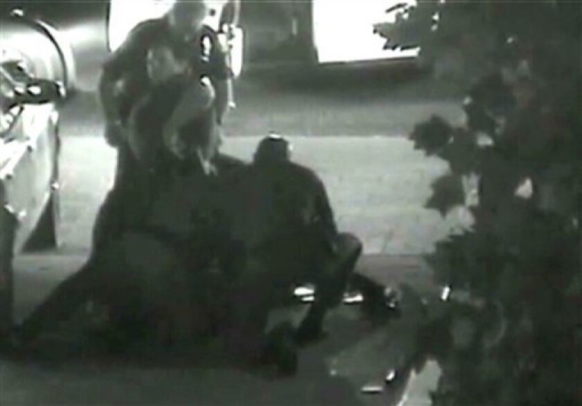 This still photo taken from a security camera released on Monday May 7, 2012 by the Orange County District Attorney shows an altercation between Fullerton police officers and homeless Kelly Thomas at the Fullerton bus depot on July 5,2011.  The grainy black and white video of Thomas' violent encoun
