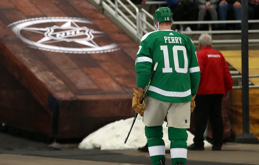 Dallas Stars Corey Perry leaves the arena after receiving a game misconduct penalty on Jan. 1 at the 2020 Winter Classic.