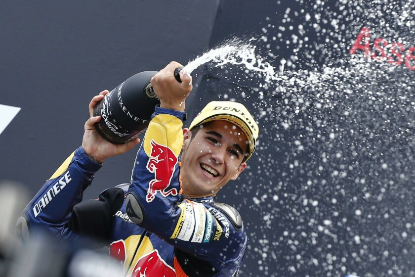 FILE, In this Saturday June 29 2013 file photo, Luis Salom of Spain celebrates his victory during the podium ceremony of the Moto3 race of the Dutch Grand Prix in Assen, northern Netherlands. MotoGP officials say Moto2 rider Luis Salom has died after crashing during practice for the Catalunya Grand