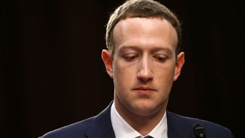 """Facebook CEO Mark Zuckerberg testifies before a U.S. Senate joint hearing on Capitol Hill as seen in """"Frontline's"""" documentary """"The Facebook Dilemma."""""""