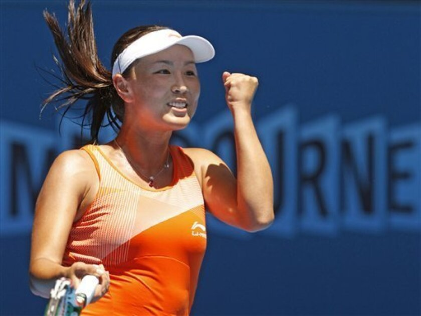 Peng Shuai of China celebrates after beating Jelena Jankovic of Serbia during their second round match at the Australian Open tennis championships in Melbourne, Australia, Thursday, Jan. 20, 2011.   (AP Photo/Rob Griffith)