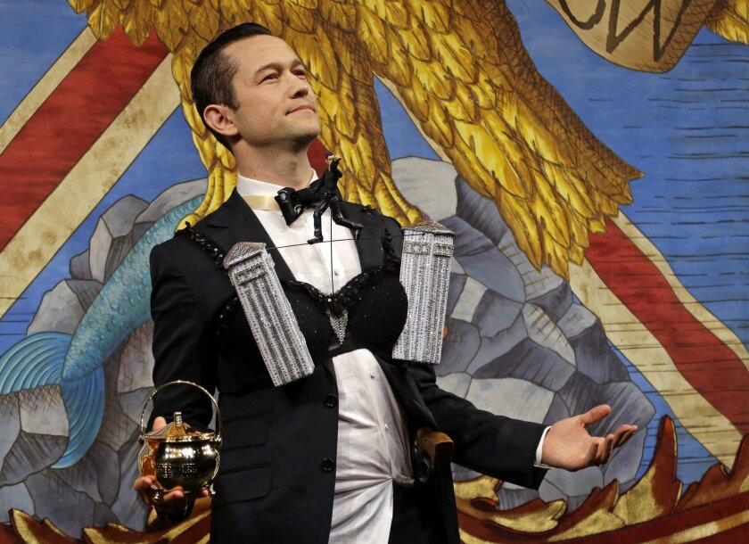 Actor Joseph Gordon-Levitt wears a bra and holds the pudding pot as he is roasted onstage as Harvard University's Hasty Pudding Theatricals Man of the Year, Friday, Feb. 5, 2016, in Cambridge, Mass. (AP Photo/Elise Amendola)