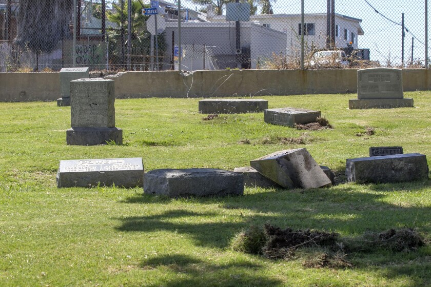 Damaged tombstones