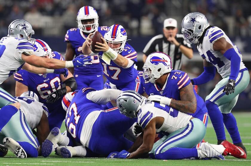 Buffalo Bills quarterback Josh Allen lunges for a first down.