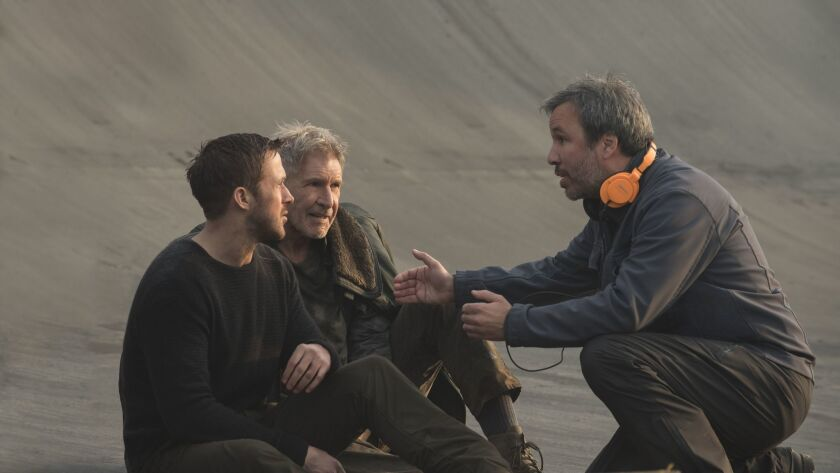 "(L-R) Ryan Gosling, Harrison Ford and director Denis Villenueve on the set of ""Blade Runner 2049."""