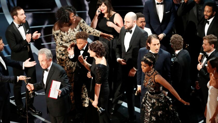 """Warren Beatty commands the microphone to explain what went wrong when """"La La Land"""" was mistakenly announced as best picture."""