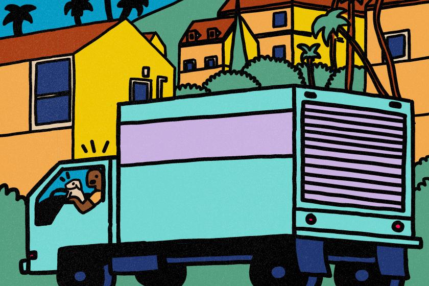 A moving truck drives through L.A.