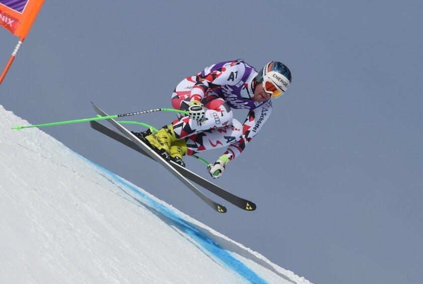Austria's Vincent Kriechmayr speeds down the slope during an Alpine ski, men's downhill training, in Chamonix, France, Thursday, Feb. 18, 2016. (AP Photo/Pier Marco Tacca)