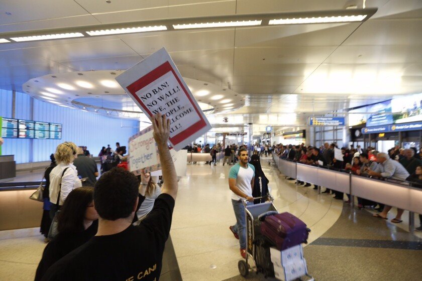 A crowd protests President Trump's travel ban at the Tom Bradley Terminal at LAX on Sunday.