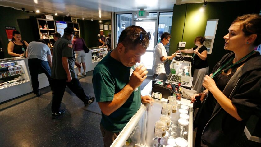 Customers shop for marijuana at a store in Denver.