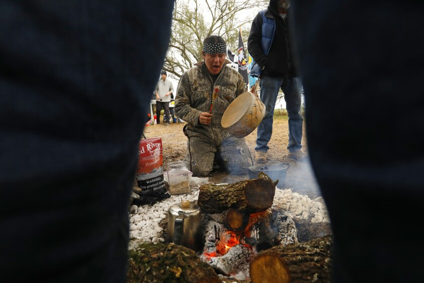 PHARR, TEXAS--FEB. 9, 2019--Volunteer protesters gather in a prayer circle at the site of a cemeter