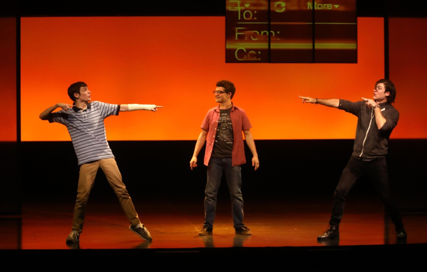 "Ben Levi Ross, left, as Evan Hansen, Jared Goldsmith and Marrick Smith perform in ""Dear Evan Hansen"" at the Ahmanson Theatre in Los Angeles."