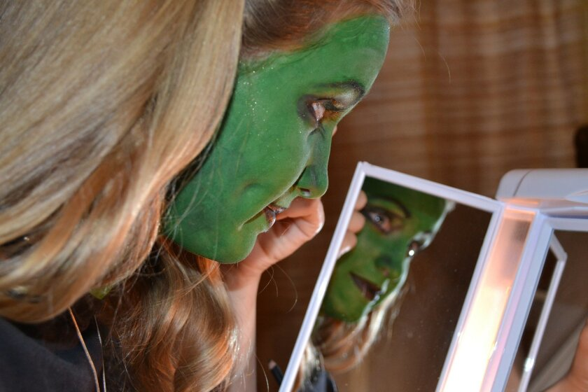 Emily Smedley, who studies with Theatre Arts School of San Diego founder Courtney Corey, works on her makeup skills.