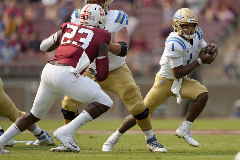 UCLA quarterback Dorian Thompson-Robinson scrambles against Stanford