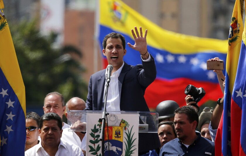 Juan Guaido, head of Venezuela's opposition-run congress, speaks to supporters at a rally where he declared himself interim president until new elections can be called in Caracas, Venezuela, on Jan. 23, 2019.