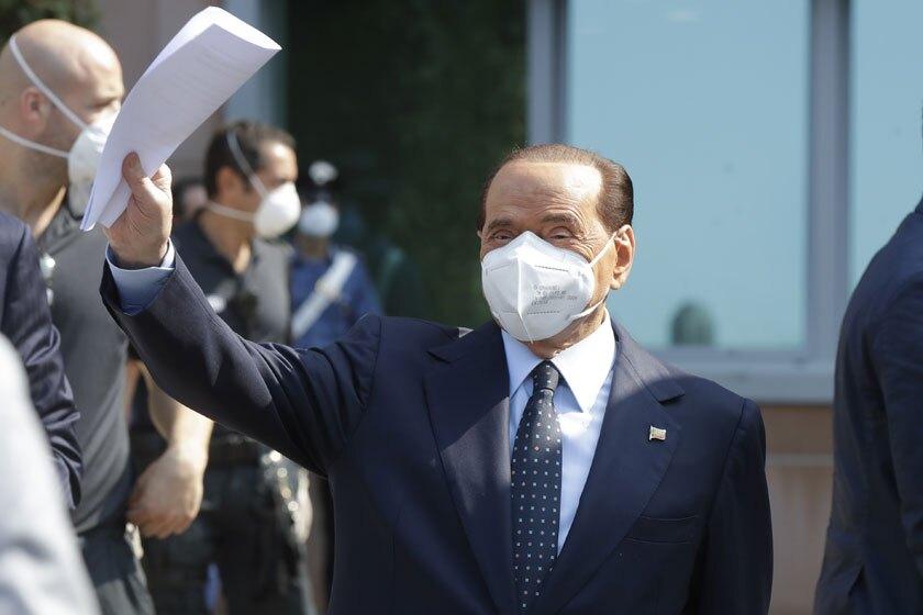 Former Italian Premier Silvio Berlusconi leaves the San Raffaele hospital in Milan, Italy, on Monday.