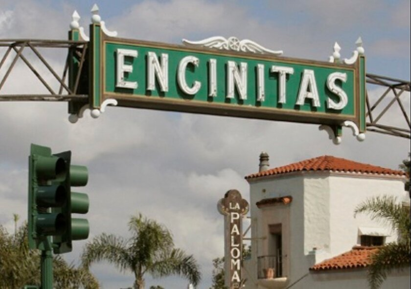 Not to be outdone by signs down south, the Encinitas sign shines above South Coast Highway 101 near the historic La Paloma Theater. It went up in 2000 to replicate the original sign taken down in 1937 to widen the road.