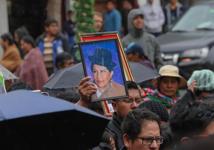 Citizens take part in the funeral procession in La Paz on Dec. 17, 2018, for the mortal remains of Bolivia's first female Aymara legislator, Remedios Loza, who had a vigil held in her honor at the nation's Legislative Assembly amid displays of affection and remembrances of her struggle for gender equality. EFE-EPA/Martin Alipaz