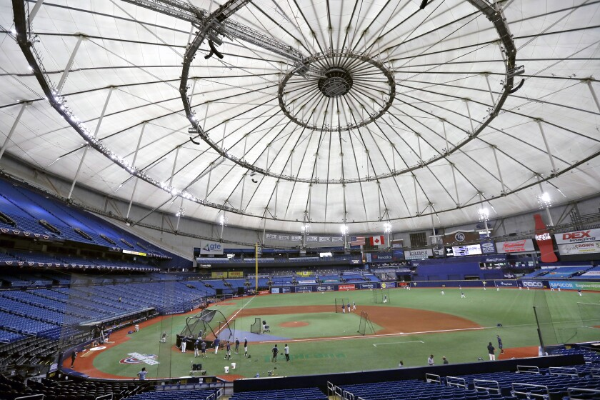 FILE - In this July 24, 2020, file photo, Members of the Tampa Bay Rays take batting practice at Tropicana Field before a baseball game against the Toronto Blue Jays in St. Petersburg, Fla. The Rays have a scheme to play half their home games in St. Petersburg and the other half in another city some 1,500 miles away. (AP Photo/Chris O'Meara, File)