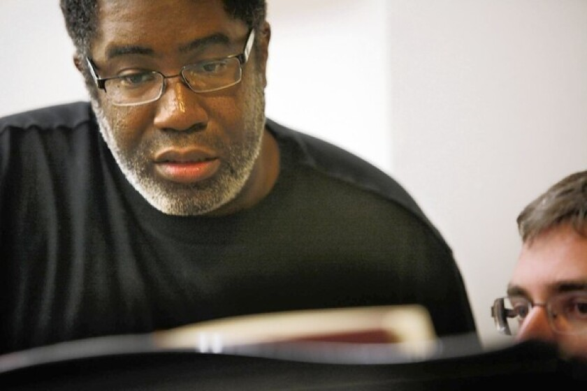 """Tenor Eric Owens goes over music with pianist Jeremy Frank during rehearsal for Owens' first """"Madame Butterfly"""" with LA Opera at the Music Center."""