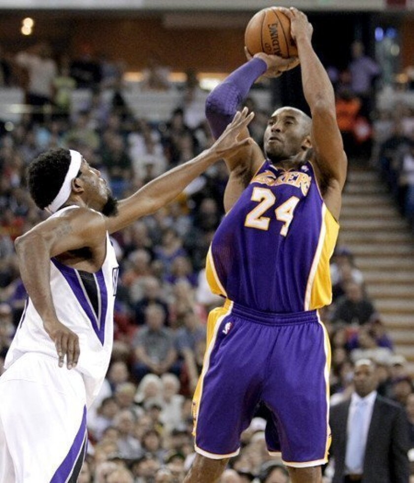 Lakers guard Kobe Bryant pulls up for a jumper over Kings forward John Salmons in the first half Saturday night in Sacramento.
