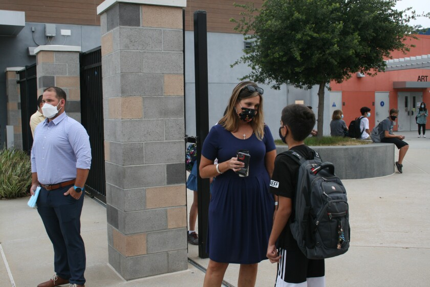 Pacific Trails Middle School Principal Mary Anne Nuskin helps a student on the first day of school.