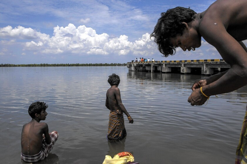 Bangladeshi migrants bathe in the sea at a temporary shelter in Kuala Langsa, Aceh province, Indonesia, on May 18, 2015.