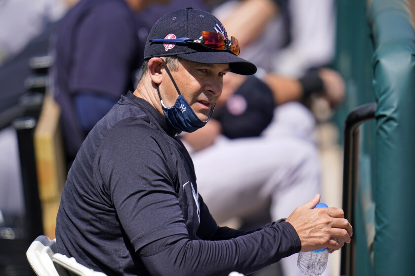 New York Yankees manager Aaron Boone takes a drink of water during a spring training exhibition baseball game against the Detroit Tigers at Joker Marchant Stadium in Lakeland, Fla., Tuesday, March 9, 2021. (AP Photo/Gene J. Puskar