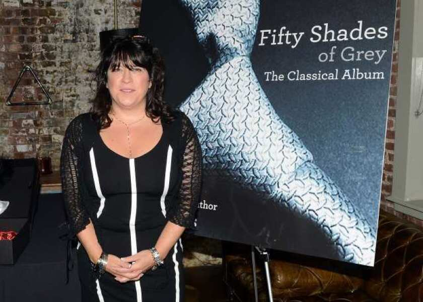 """Author E.L. James poses at the """"Fifty Shades Of Grey: The Classical Album"""" launch event at the Soho House in New York."""