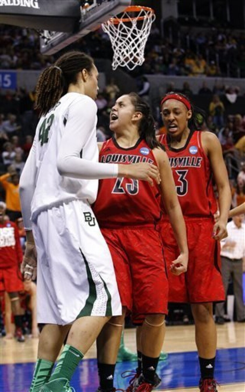 Louisville's guard Shoni Schimmel, center, reacts to her shot over Baylor's Brittney Griner, left, as Louisville's Sheronne Vails, right, stands by during the second half of a regional semifinal in the women's NCAA college basketball tournament in Oklahoma City, Sunday, March 31, 2013. Louisville w