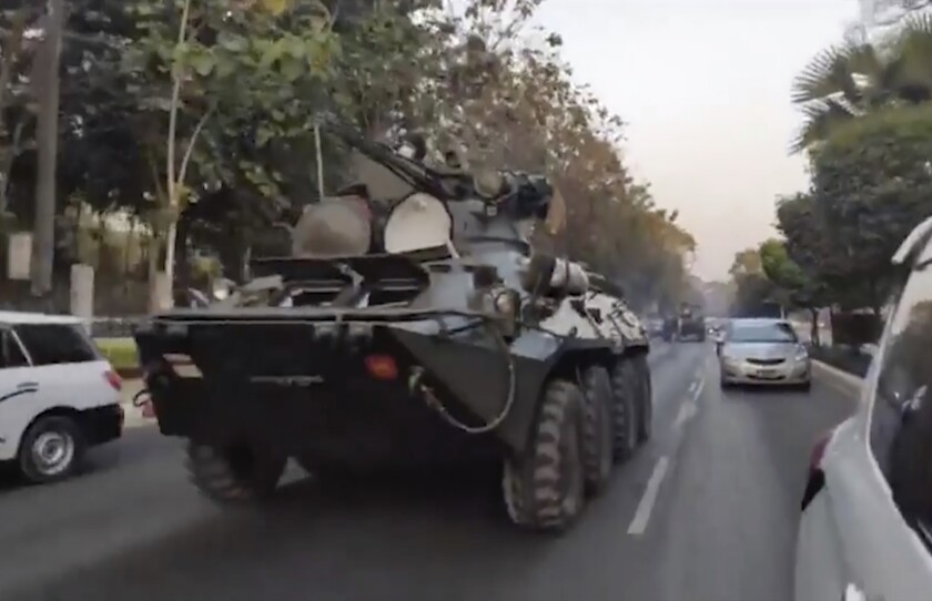In this image made from video by the Democratic Voice of Burma (DVB), two armored personnel carriers were seen traversing on a road in Yangon, Myanmar, Sunday, Feb. 14, 2021. Sightings of armored personnel carriers in Myanmar's biggest city and an internet shutdown raised political tensions late Sunday, after vast numbers of people around the country flouted orders against demonstrations to protest the military's seizure of power. (DVB via AP)
