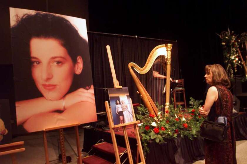 A mourner looks at a picture of Chandra Levy at a memorial service in Modesto in 2002.