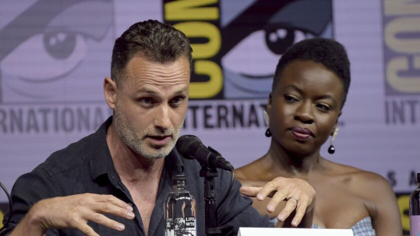 "Danai Gurira, right, looks on as Andrew Lincoln speaks at a panel for ""The Walking Dead"" on day two of Comic-Con International."