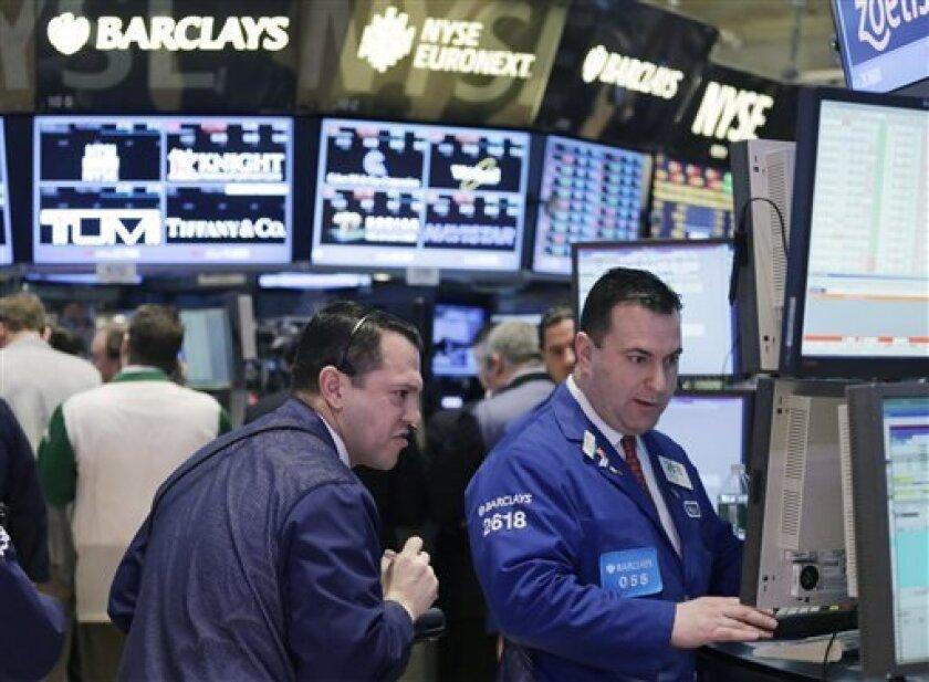 Stock traders work at the New York Stock Exchange, Monday, Feb. 4, 2013. (AP Photo/Mark Lennihan)