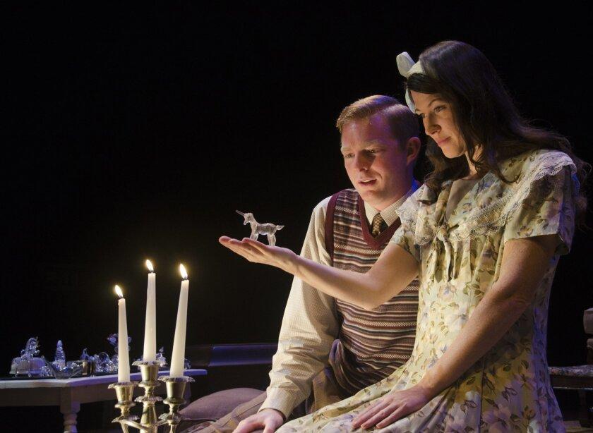 Jim (Brian Mackey) and Laura (Amanda Sitton) share an intimate moment. Photo J.T. MacMillan