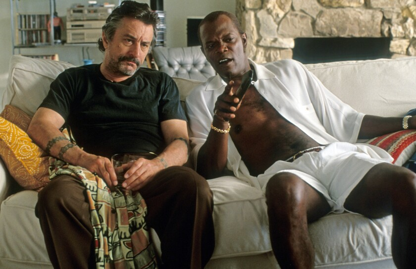 "Robert De Niro and Samuel L Jackson sit on a couch in a scene from ""Jackie Brown."""
